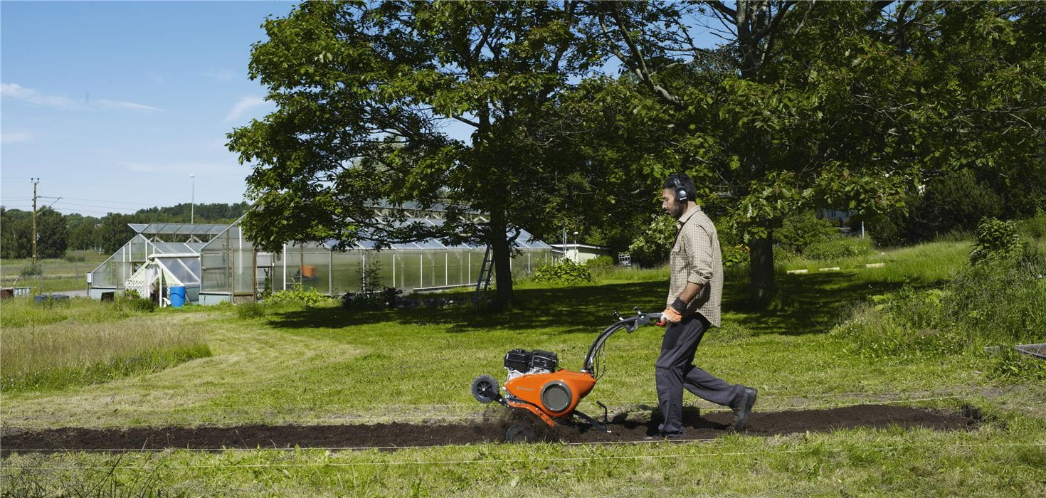 Cultivating the soil with a Husqvarna Tiller